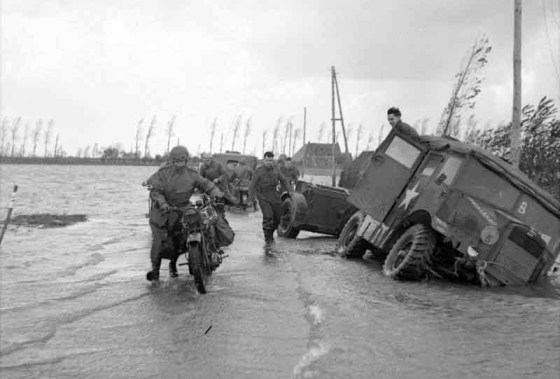 Allied troops contend with rising waters in Holland. As many as a third of the country's floods have been caused by warring armies. (Image source: WW2 Today)