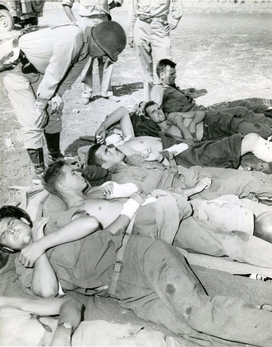 Patton tours a field hospital. (image source WikiCommons)