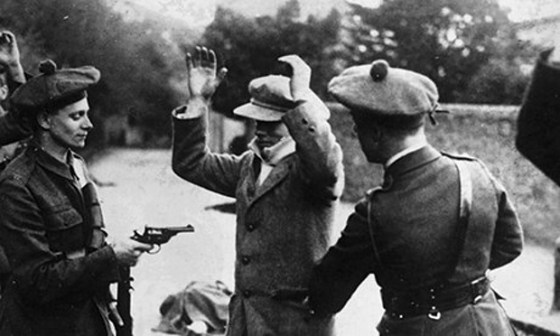 Members of the Black and Tans detain a suspected IRA operative.