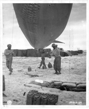 The men of the 320th prepare to launch their hydrogen barrage balloons. (Image source: U.S. National Archives)