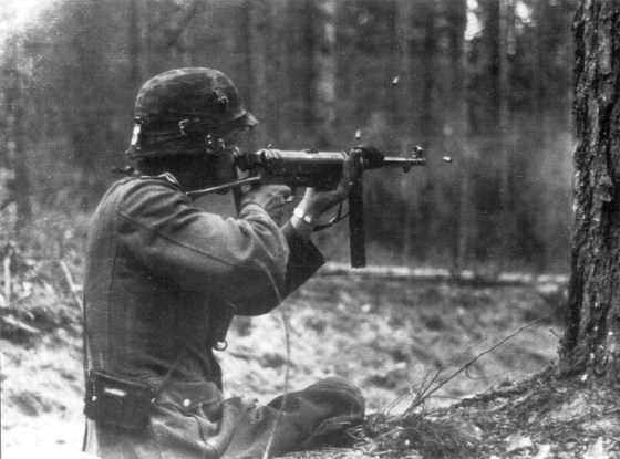 A soldier fires a MP-40.