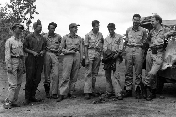 This photo of the Gowdy crew was taken just after they had bailed out from their malfunctioning B-24 on June 11, 1943. From left to right, the men are: Yawn, tail gunner; Powell, engineer; McKnight, waist gunner; Stewart, student navigator; Buchanan, bombardier; Cowan, radio operator; McMahon, navigator; and Gowdy, pilot. Note that each man is carrying the d-ring from his parachute, pulled just after jumping. Gowdy had told the crew that whoever lost his ring had to buy a round of drinks for the rest of them. (Image source: Walter E. Buchanan, Jr. Collection via Walter E. Buchanan III)