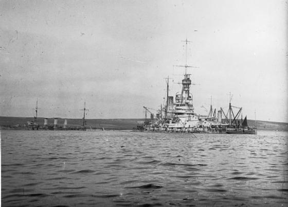 Salvage work underway in Scapa Flow. The Cruiser Baden is in the foreground. (Image source: WikiCommons)