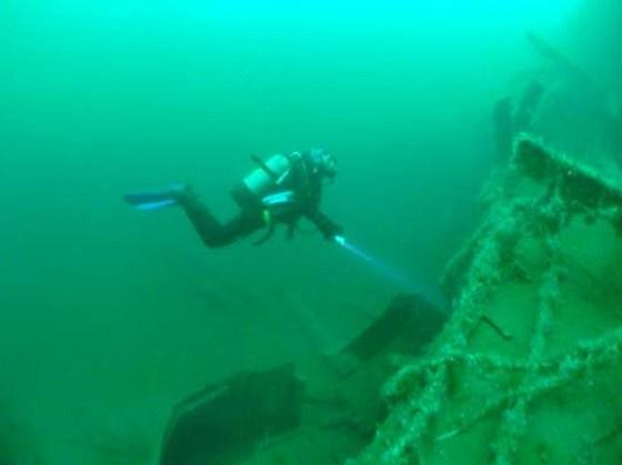 A diver explores a Scapa Flow wreck.