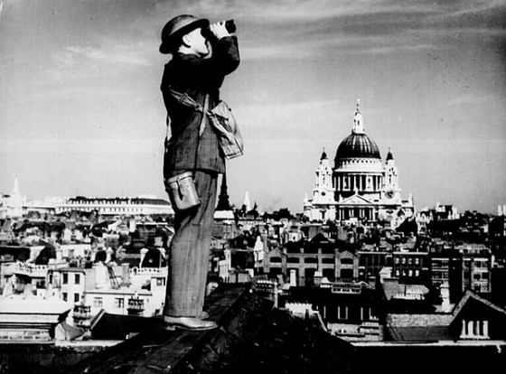 A lookout scans the skied above London during the Blitz. (Image source: WikiCommons)