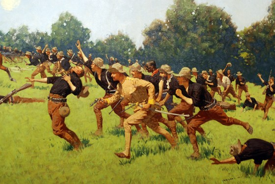 Theodore Roosevelt leads the Rough Riders up San Juan Hill.