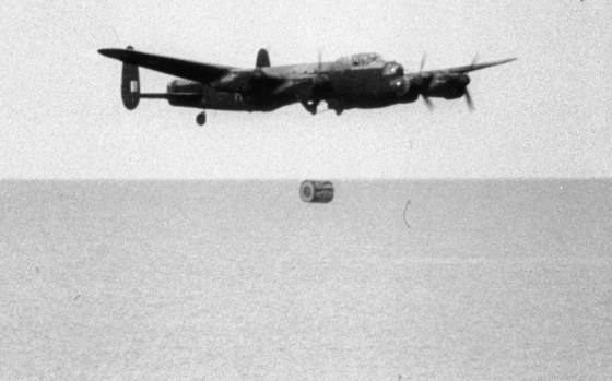 "A ""Dam Buster"" Lancaster releases a top secret Upkeep 'bouncing bomb.' (Image source: WikiCommons)"