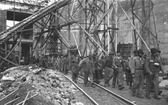 Forced labourers at marched from building U-boat pens at Bremen. Millions of Europeans were abducted from their homes and forced to work in Nazi Germany during World War Two. A new book explores their plight. (Image source: WikiCommons)