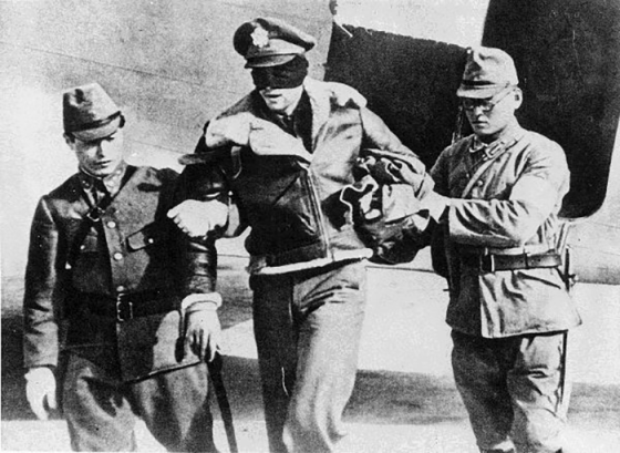 American Doolittle Raider, Lt. R.L. Hite is escorted by Kempeitai into captivity. Three of the seven fliers captured in the operation were executed. (Image source: WikiCommons)
