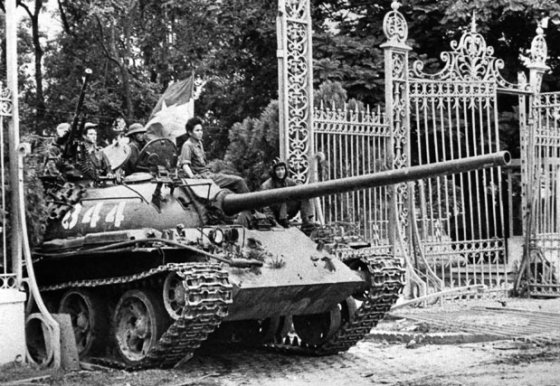 A North Vietnamese tank crashes through the gate of Saigon's presidential palace, April 30, 1975.