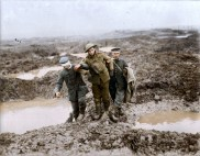 German POWs help a wounded Canadian soldier across No Man's Land. (Image source Canada. Dept. of National Defence/Library and Archives Canada via the Vimy Foundation)
