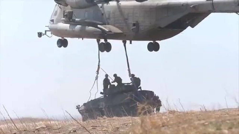 CH-53E Helicopter Lifts LAV-25 Light Armored Vehicle