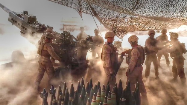 Marines Fire  M777A2 Howitzers In Desert