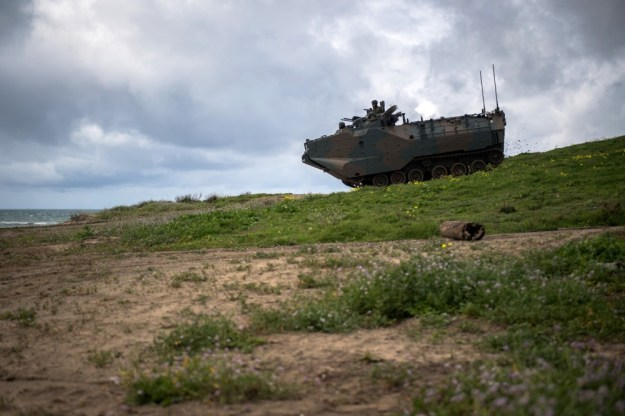 A Japan Ground Self-Defense Force amphibious assault vehicle drives downhill during Exercise Iron Fist 2019. (U.S. Navy photo by Mass Communication Specialist 2nd Class Devin M. Langer)