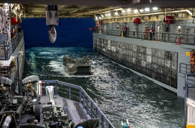A Japanese amphibious assault vehicle enters the well deck of the amphibious transport dock ship USS Somerset (LPD 25) during Exercise Iron Fist 2019. (U.S. Navy photo by Mass Communication Specialist 2nd Class Devin M. Langer)