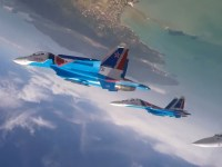 Russian Knights team perform aerobatic maneuvers at LIMA-2019
