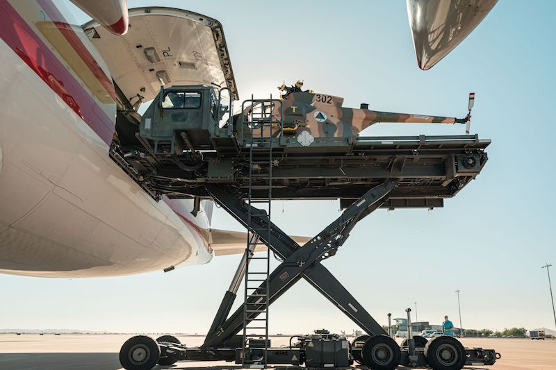 The last five Enhanced MD 530F Cayuse Warrior helicopters ordered for the Afghanistan is loaded onto a Boeing 747 for shipment to the customer.