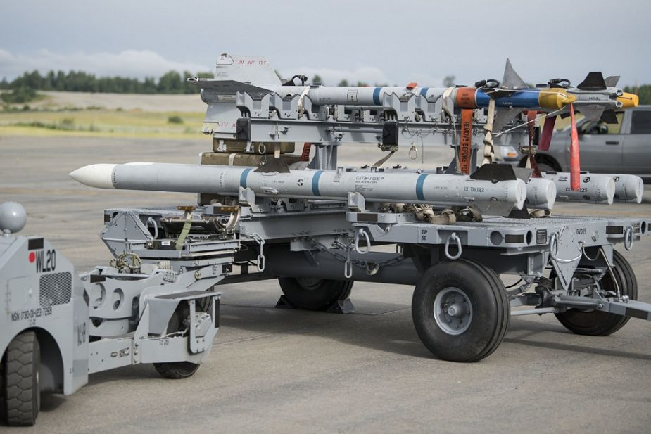 A munitions load truck containing Air Intercept Missile-120 Advanced Medium Air-to-Air Missiles AMRAAM and Air Intercept Missile-9 Sidewinders is used for an F-22 Raptor weapons load training