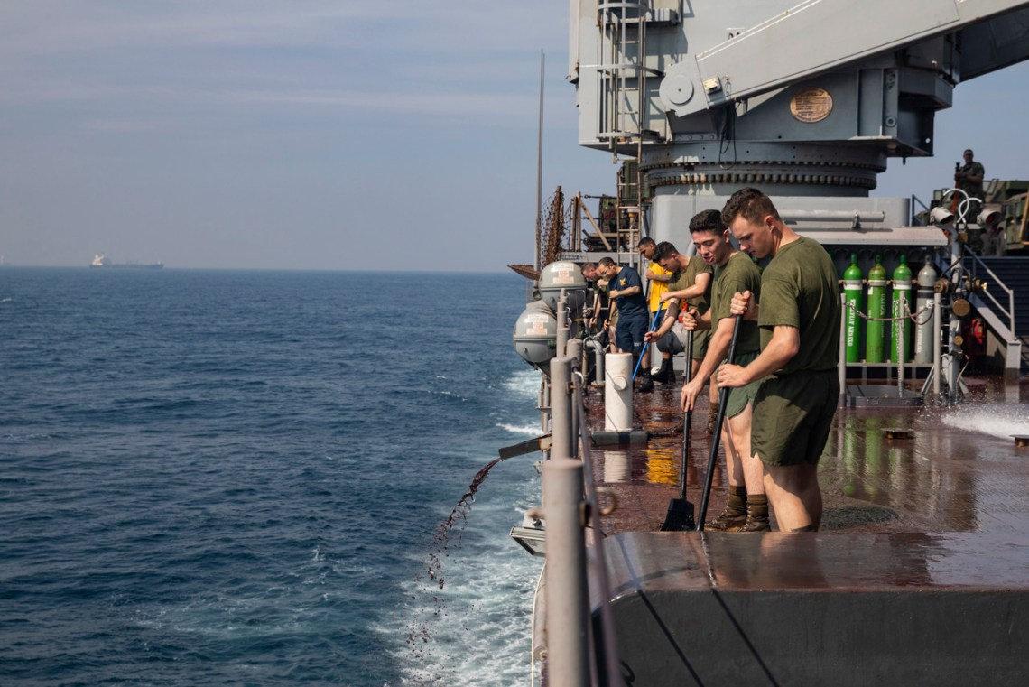 U.S. Marines and Sailors sweep aboard the USS Germantown (LSD 42) at Bay of Bengal on November 17, 2019. The Marines and Sailors clean the ship to maintain cleanliness and serviceability after visiting Visakhapatnam, India for exercise Tiger TRIUMPH. The exercise is an opportunity for professional and cultural exchanges, teamwork, expanding common ground, learning, training and increasing friendship between the U.S. and Indian militaries. The Marines are with 3rd Marine Division, III Marine Expeditionary Force. (U.S. Marine Corps photo by Lance Cpl. Armando Elizalde)