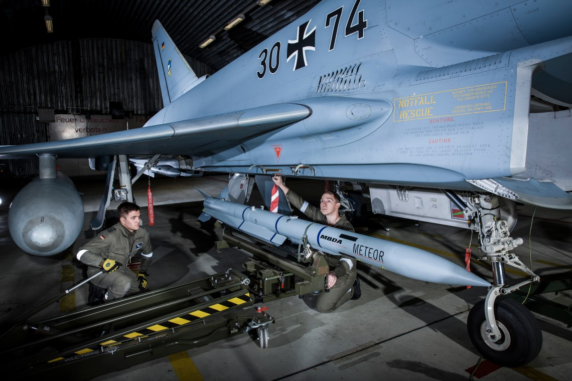 Luftwaffe ground personnel load a Meteor beyond visual-range air-to-air missile (BVRAAM) on a Eurofighter combat aircraft of the German Air Force's 74th Fighter Squadron, based at Neuburg Donau. (MBDA photo)