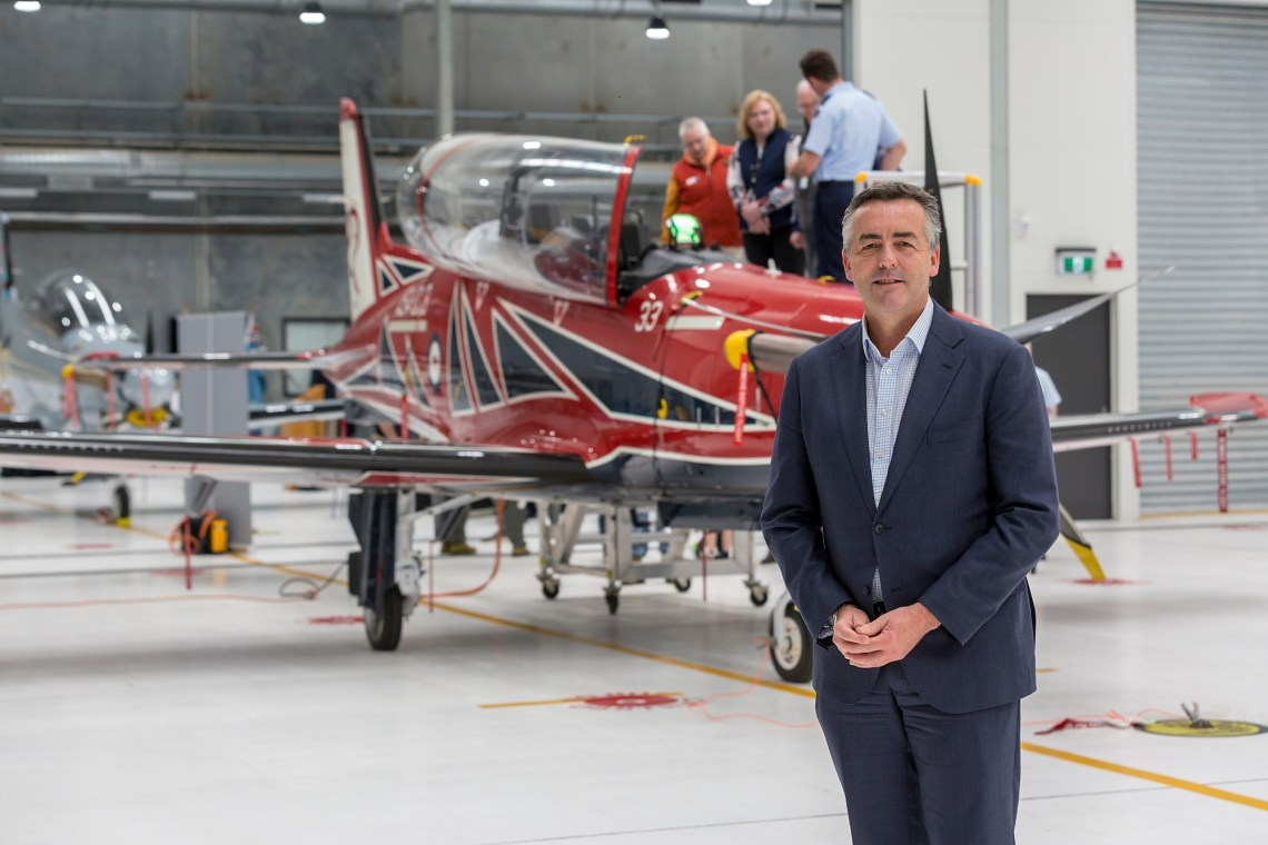 Minister for Veterans and Defence Personnel, the Hon. Darren Chester MP in front of a new RAAF Pilatus PC-21 during the final delivery ceremony at RAAF Base East Sale.