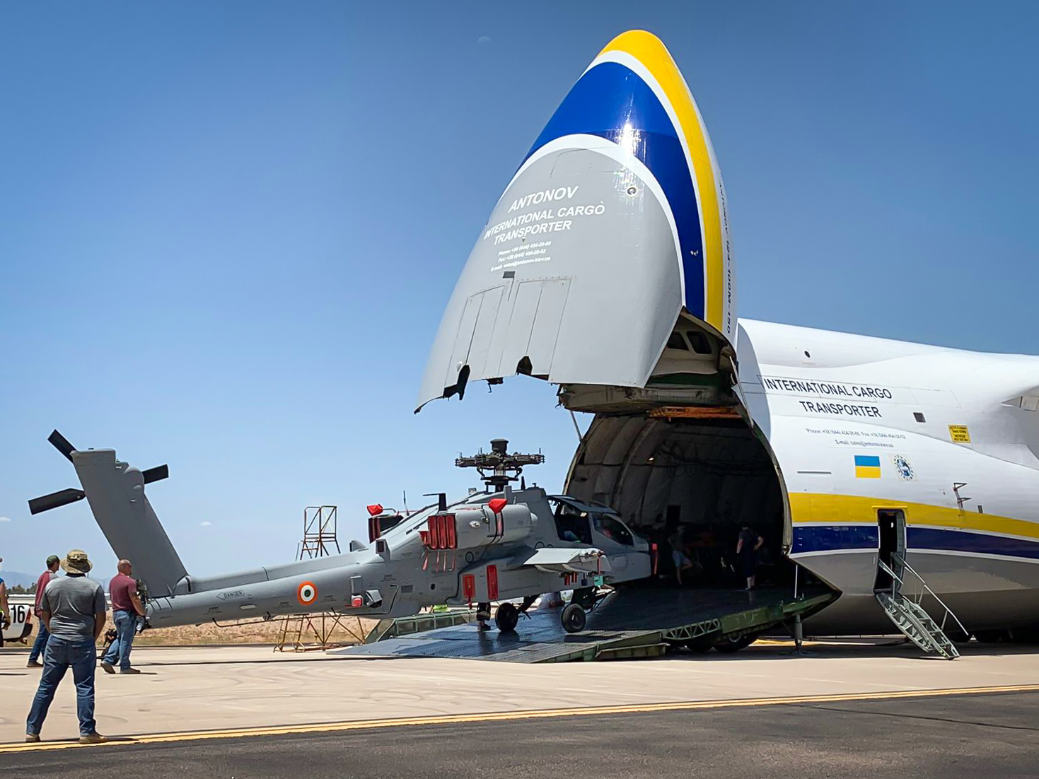 An Apache AH-64 Attack Helicopter is loaded onto an AN-124-100, which can carry up to 5 units.