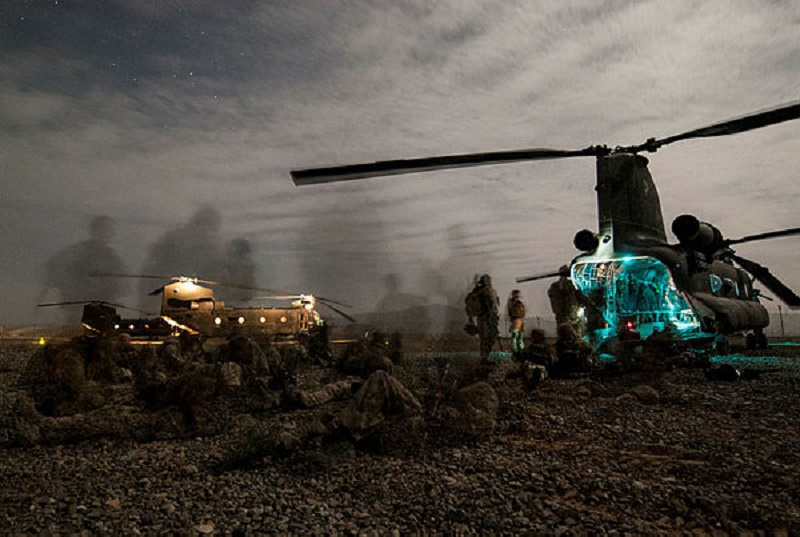 Australian Army soldiers from Special Operations Task Group prepare to board CH-47 Chinook helicopters during a night-time operation in Uruzgan province, Afghanistan, in June 2008.
