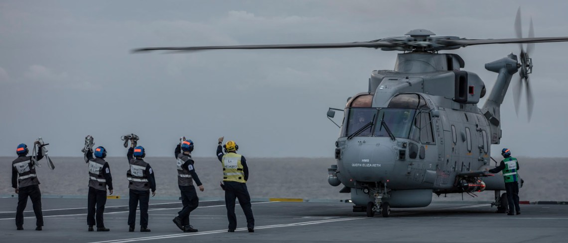 A mark 2 Anti Submarine Warfare Merlin helicopter from 820 Naval Air Squadron, drops its sonar into the Atlantic during an exercise off the East coast of the USA.