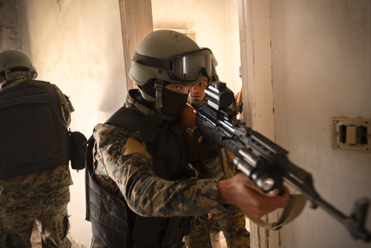 Syrian Democratic Force commando cadets clear a room during military operations in urban terrain training in Syria, Aug. 3, 2019. The SDF have made steady progress, and have adapted to Daesh tactics to continue to pressure them into smaller spaces. (U.S. Army photo by Spc. Alec Dionne)