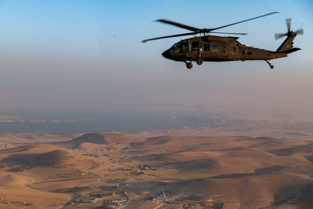 A UH-60 Blackhawk, with Combined Joint Task Force - Operation Inherent Resolve, flies over the Syrian countryside, August 17, 2019. Blackhawk helicopters are essential air assets that fulfill a variety of roles that support the enduring defeat of Daesh. (U.S. Army photo by Spc. Alec Dionne)