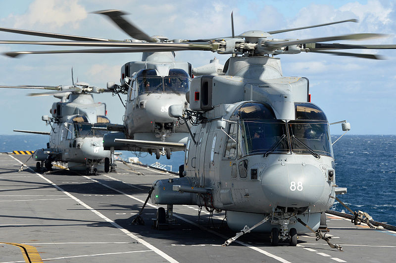 Royal Navy Merlin Mk2 helicopters on the flight deck of HMS Illustrious