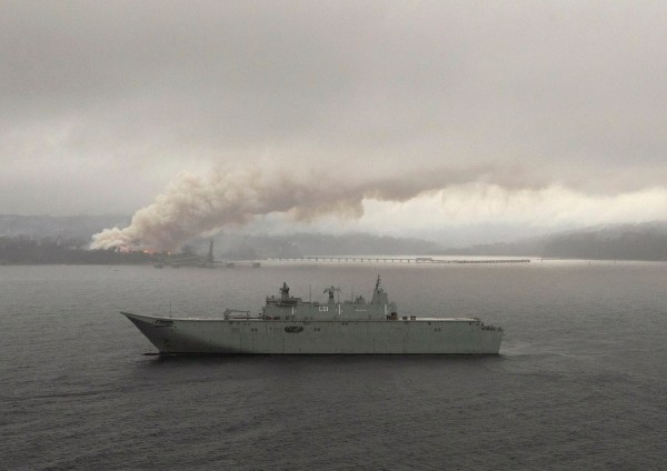 HMAS Adelaide operates off the coast of Eden, NSW as fires still burn out of control during Operation Bushfire Assist.