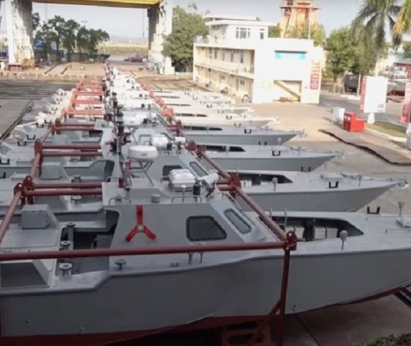 Eight Manta-type boats are seen lined up at the Hong Ha Shipbuilding Company facility in Haiphong