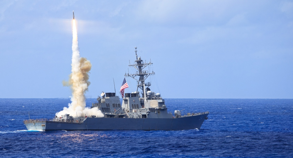 Arleigh Burke-class guided-missile destroyer USS Curtis Wilbur (DDG 54) fires a Standard Missile 2 (SM-2) during a missile firing exercise