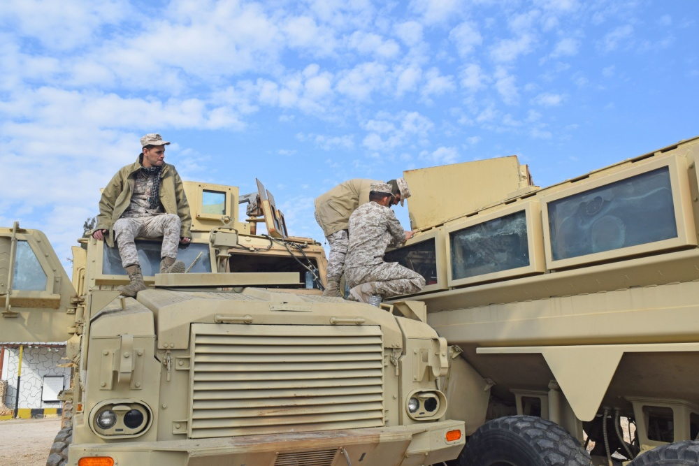 A Jordan Armed Forces-Arab Army (JAF) Soldiers performs maintenance on a Mine Resistant Ambush Protected Wheeled Armor Vehicle during a Subject Matter Expert Exchange with Military Engagement Team-Jordan