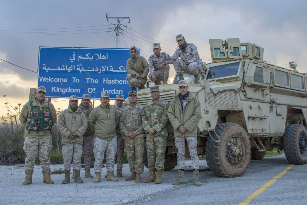 Jordan Armed Forces-Arab Army (JAF) Soldiers pose for a photo with Arizona Army National Guard, during a Mine Resistant Ambush Protected Wheeled Armor Vehicle at a base outside of Amman, Jordan in January.