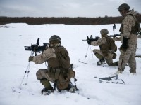 U.S. Marines from Golf Company, 2nd Battalion, 3rd Marine Regiment, 3rd Marine Division, fire in a modified kneeling position for a live fire ski range during exercise Northern Viper 2020