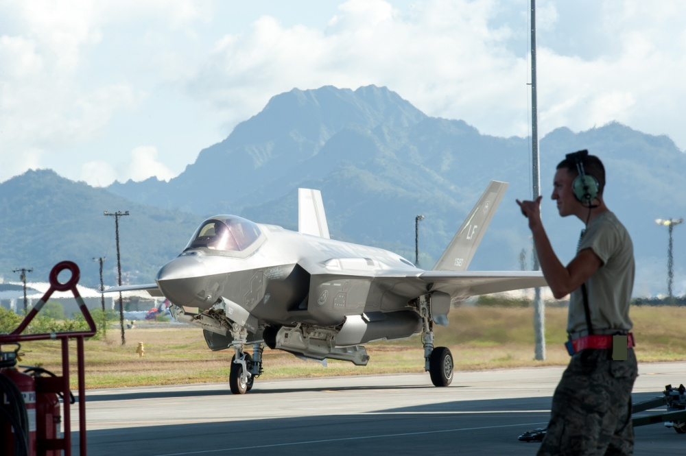 Airman 1st Class Jordan Partin, 15th Aircraft Maintenance Squadron F-22 Raptor crew chief, cheers on an F-35A Lightning II Jan. 30, 2020, at Joint Base Pearl Harbor-Hickam, Hawaii.