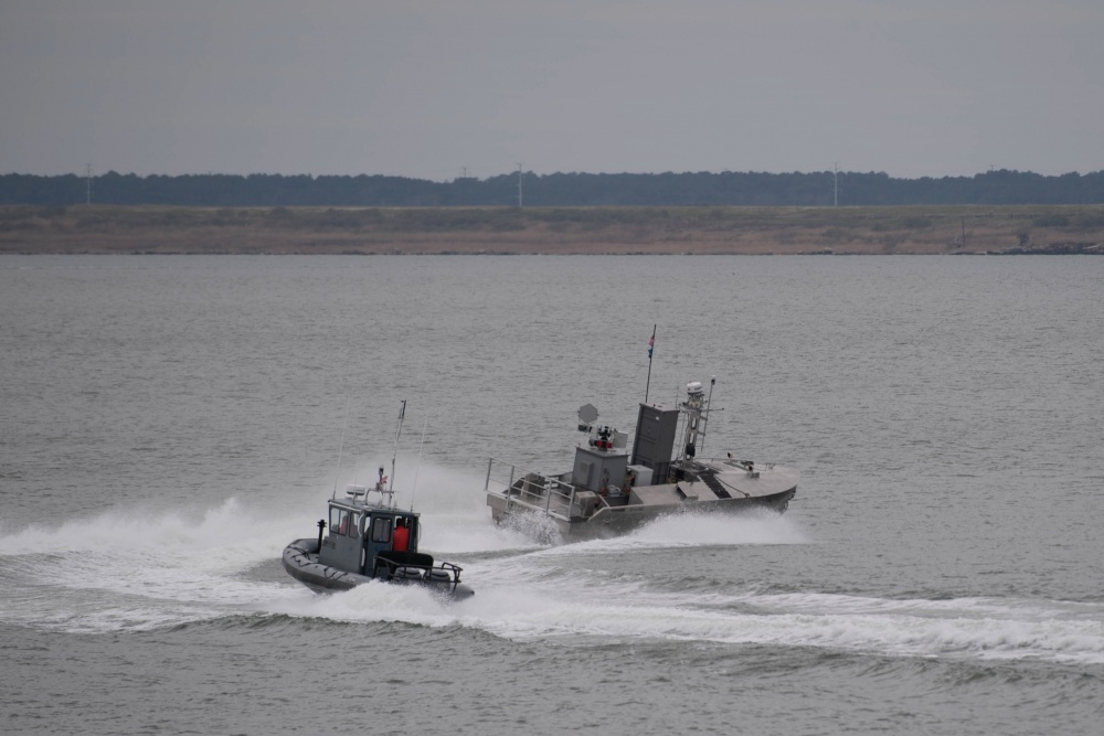 A developmental, early variant of the Common Unmanned Surface Vehicle (CUSV) autonomously conducts maneuvers on the Elizabeth River during its demonstration during Citadel Shield-Solid Curtain 2020 at Naval Station Norfolk. (U.S. Navy photo by Mass Communication Specialist 3rd Class Rebekah M. Rinckey/Released)