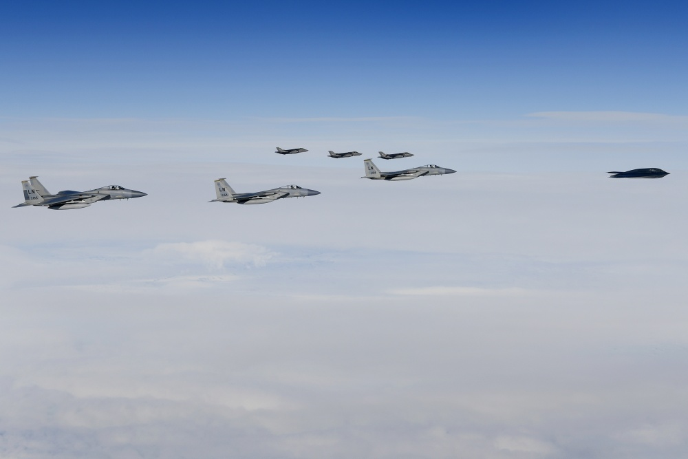 A B-2A Spirit bomber assigned to the 509th Bomb Wing is escorted by F-15C Eagles assigned to the 48th Fighter Wing and Royal Norwegian Air Force F-35A aircraft in support of Bomber Task Force Europe 20-2 over Keflavik, Iceland, March 17, 2020.