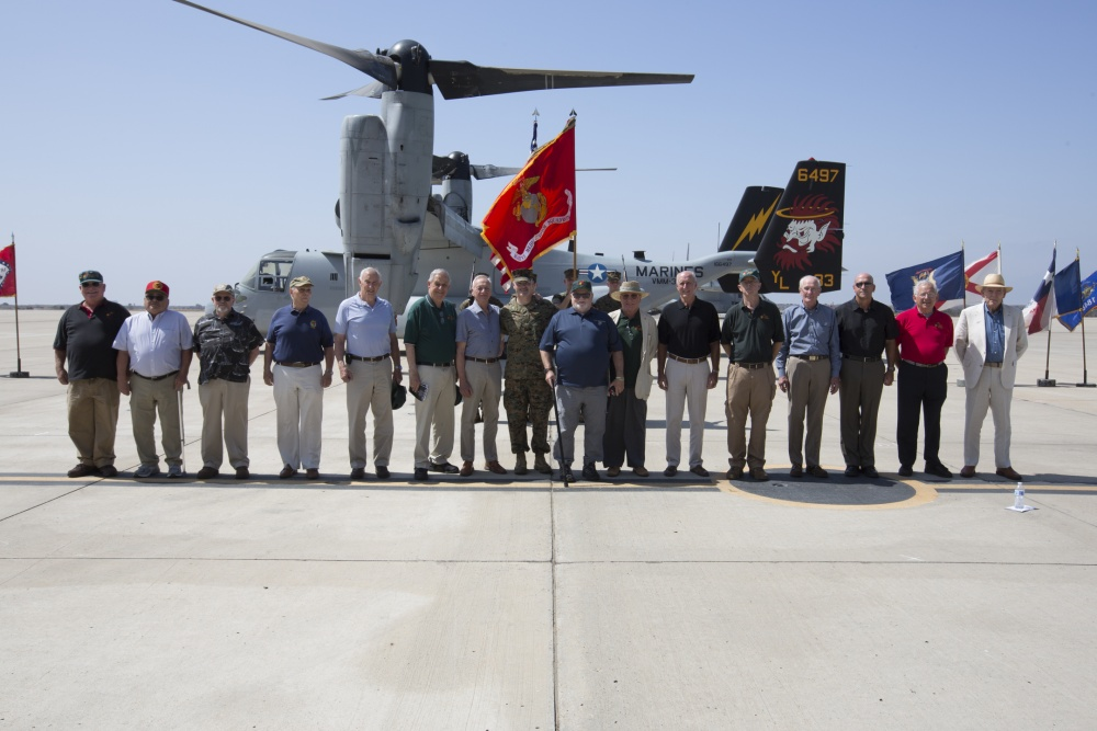 Former Marine Heavy Helicopter Squadron (HMH) 362 members gather during the Marine Medium Tiltrotor Squadron (VMM) 362, Marine Aircraft Group 16, 3rd Marine Aircraft Wing, activation ceremony at Marine Corps Air Station Miramar, Calif., Aug. 17.