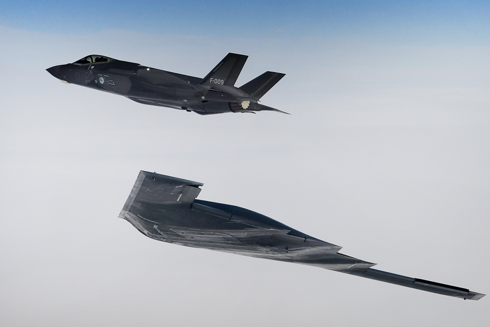 A U.S. B-2A Spirit bomber assigned to the 509th Bomb Wing and a Royal Netherlands air force F-35A conduct aerial operations in support of Bomber Task Force Europe 20-2 over the North Sea March 18, 2020.