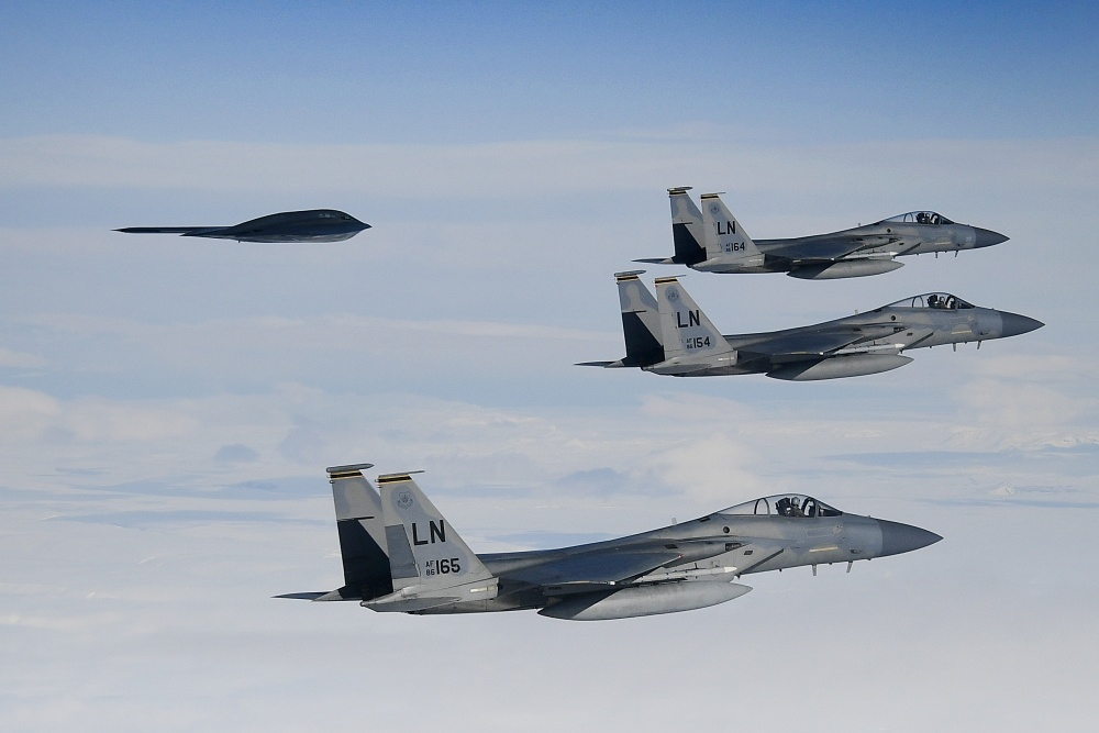 F-15C Eagles assigned to the 493rd Fighter Squadron conduct aerial operations with a B-2A Spirit in support of Bomber Task Force Europe 20-2 over the Keflavik, Iceland March 16, 2020.