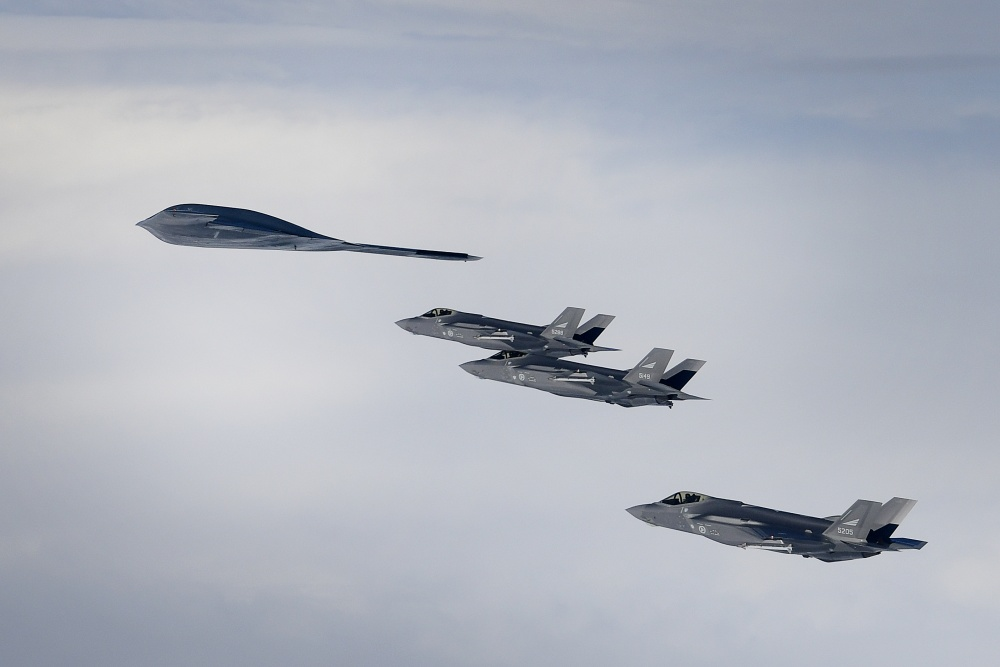 Royal Norwegian Air Force F-35A aircraft and a U.S. Air Force B-2A Spirit bomber conduct aerial operations in support of Bomber Task Force Europe 20-2 over Keflavik, Iceland March 16, 2020.