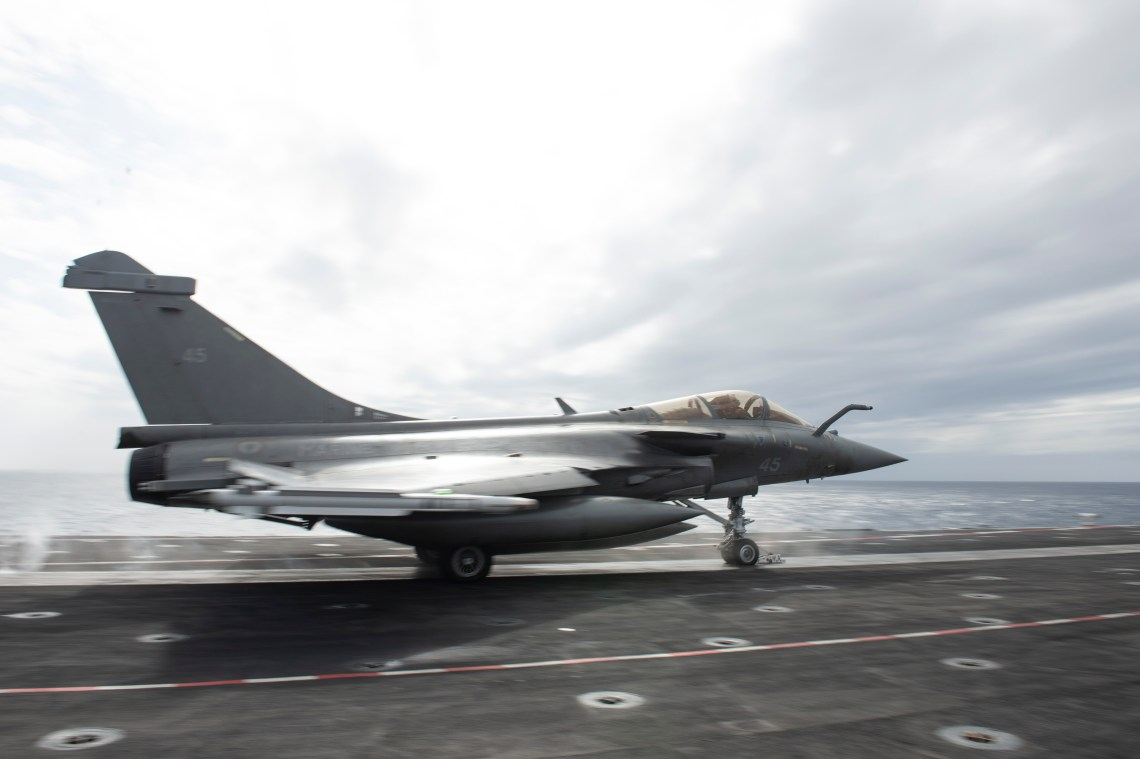 French Dassault Rafale M fighter jet launches from the flight deck aboard the French aircraft carrier Charles De Gaulle (R 91) while conducting interoperability exercises with the aircraft carrier USS Dwight D. Eisenhower (CVN 69).