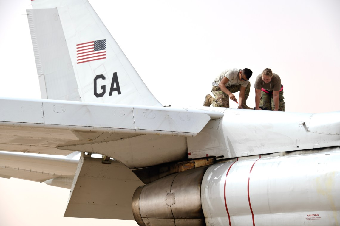U.S. Air Force crew chiefs assigned to the 379th Expeditionary Maintenance Squadron, conduct maintenance on an E-8C Joint Surveillance Target Attack Radar System (JSTARS) at Prince Sultan Air Base, Kingdom of Saudi Arabia, March 8, 2020.