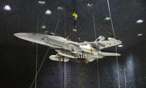 Two Next Generation Jammer Mid-Band pods, attached to an EA-18G Growler, undergo testing in the Air Combat Environmental Test and Evaluation Facility anechoic chamber at Naval Air Station Patuxent River, Md. (U.S. Navy photo)