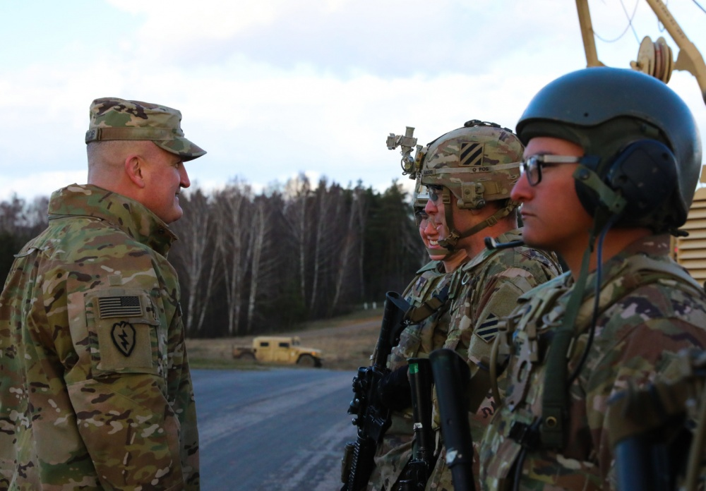 Col. Timothy O'Connor (left), 1st Infantry Division Forward Commander, speaks to Soldiers from Alpha Company, 9th Brigade Engineer Battalion, 2nd Brigade Combat Team, during a base tour at Ziemsko Airfield, Poland, on March 11, 2020.
