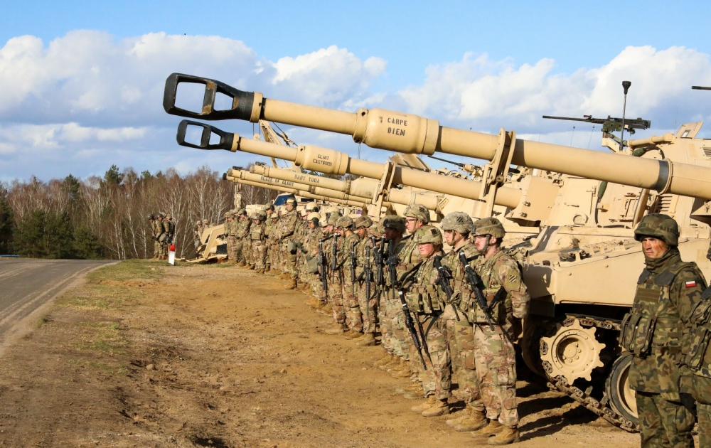 U.S. Army soldiers from 9th Brigade Engineer Battalion, 2nd Brigade Combat Team, stand alongside their Polish counterparts during a base visit at the Ziemsko Airfield, Poland, on March 11, 2020.