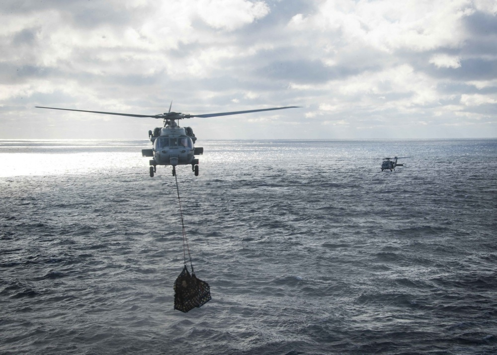 MH-60S Sea Hawk helicopters, attached to Helicopter Sea Combat Squadron (HSC) 9, conduct a vertical replenishment-at-sea from the USNS Joshua Humphreys (T-AO 188) to the USS Gerald R. Ford (CVN 78) March 24, 2020. Ford is underway conducting carrier qualifications in the Atlantic Ocean. (U.S. Navy photo by Mass Communication Specialist 3rd Class Zachary Melvin)